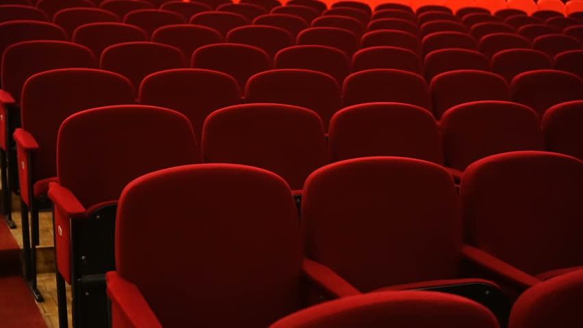 Rows of empty red velvet seats inside a theater or opera. | Shutterstock HD Video #1024491320