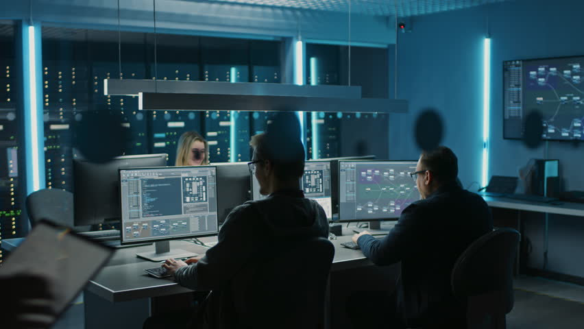 Team of IT Programers Working on Desktop Computers in Data Center Control Room. Young Professionals Writing on Sophisticated Programming Code Language Royalty-Free Stock Footage #1024519520