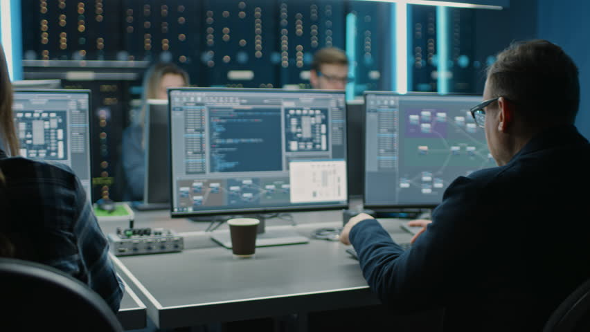 Team of IT Programers Working on Desktop Computers in Data Center Control Room. Young Professionals Writing on Sophisticated Programming Code Language | Shutterstock HD Video #1024519532