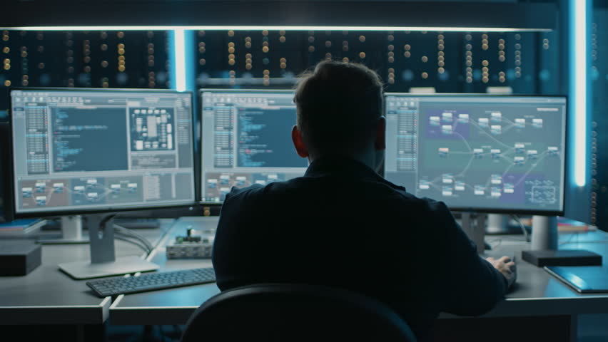 Professional IT Programer Working in Data Center on Desktop Computer with Three Displays, Doing Development of Software and Hardware. Displays Show Blockchain, Data Network Architecture. 8K RED Royalty-Free Stock Footage #1024519628