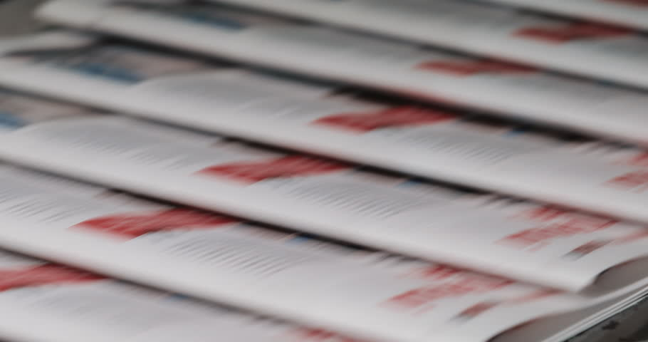 Newspapers, tabloids, print plant factory,magazine transports on conveyor belt line after printing units