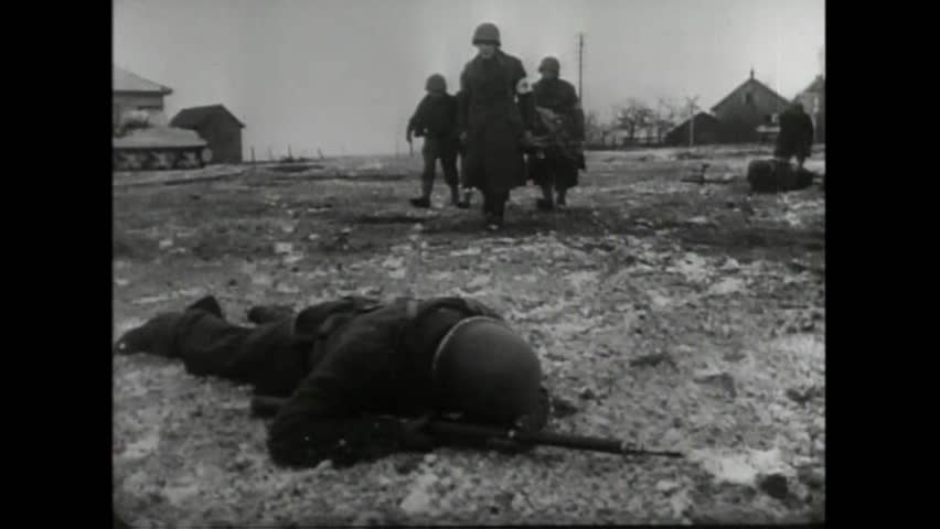 CIRCA 1940s - A group of American paratroopers fight German forces in Holland during World War 2