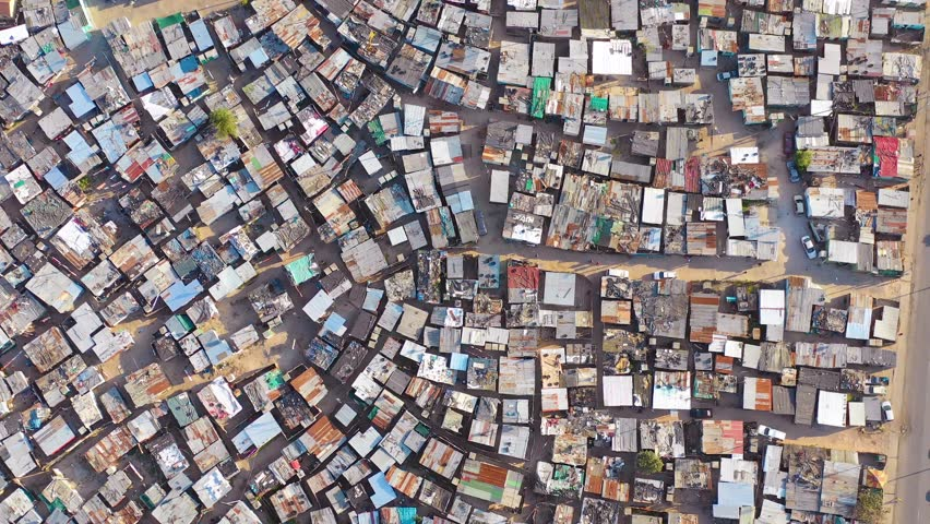 GUGULETHU, SOUTH AFRICA - CIRCA 2018 - Straight down high aerial over ramshackle township of Gugulethu, one of the poverty stricken slums.