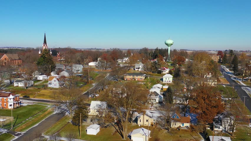 RIVERSIDE, IOWA - CIRCA 2018 - A drone aerial over a small town in America in winter snow, Riverside, Iowa. Royalty-Free Stock Footage #1024543295