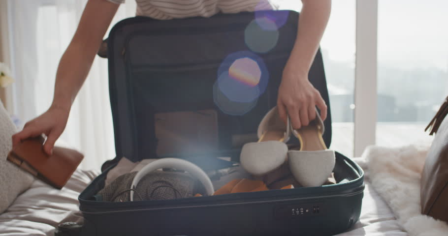 Travel woman packing suitcase getting ready for road trip preparing luggage for vacation