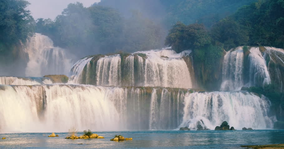 Beautiful waterfall. Ban Gioc waterfall or Detian waterfall is landmarks name of two waterfalls in border Cao Bang, Vietnam and Daxin County, China. Stock video footage  Amazing landscape for travel | Shutterstock HD Video #1024558187