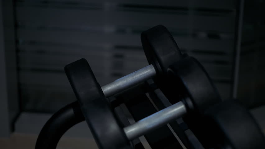 Row of dumbbells in the gym | Shutterstock HD Video #1024561478