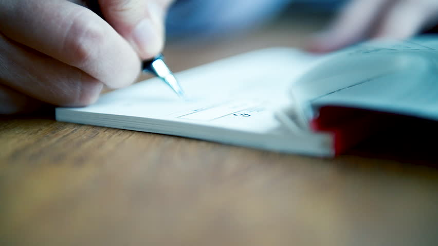 macro close-up detail of young business woman filling a banking cheque check writingwith luxury fountain pen the requested data in the luxury first class checkbook Royalty-Free Stock Footage #1024582382