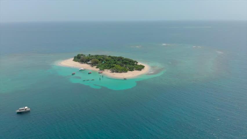 Aerial Forward: Grand View of Remote Island in Saint-Marc Haiti