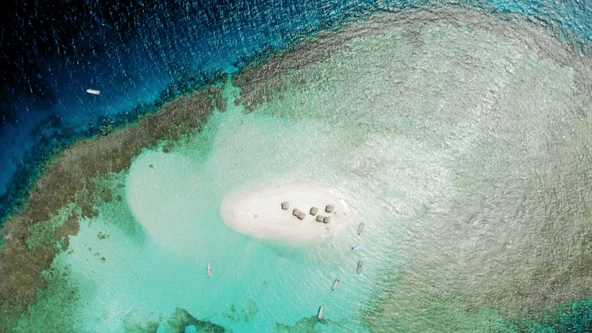 Aerial Circling: Scenic Small Island with Motorboats on Blue Water | Shutterstock HD Video #1024600559