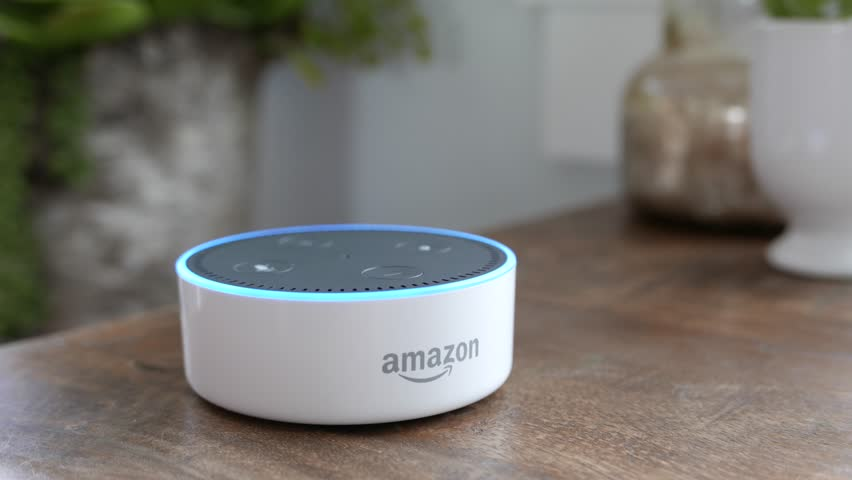 Los Angeles, CA, USA -02/21/19: Amazon Echo Dot on Tabletop. Amazon Echo Dot activates on rustic table. For editorial use.
