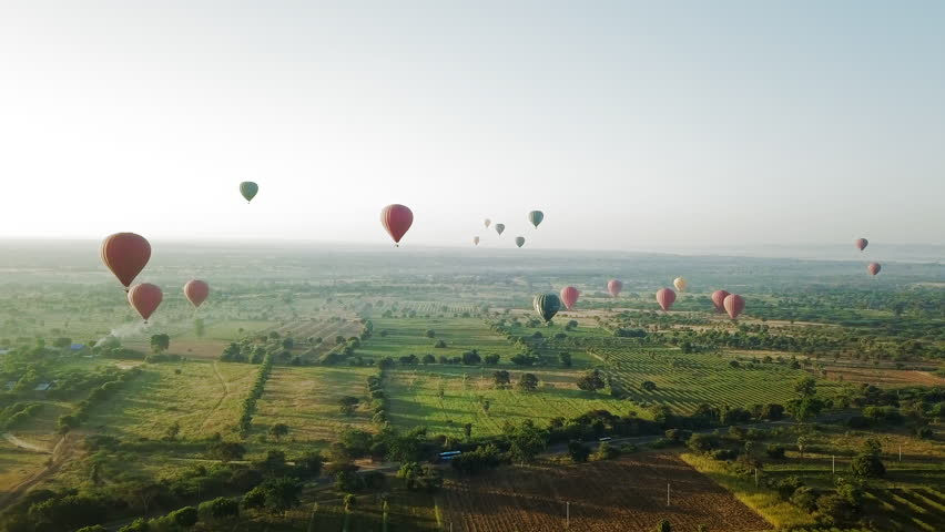 Aerial: Colorful Hot Air Balloons Soaring Over old Bagan
