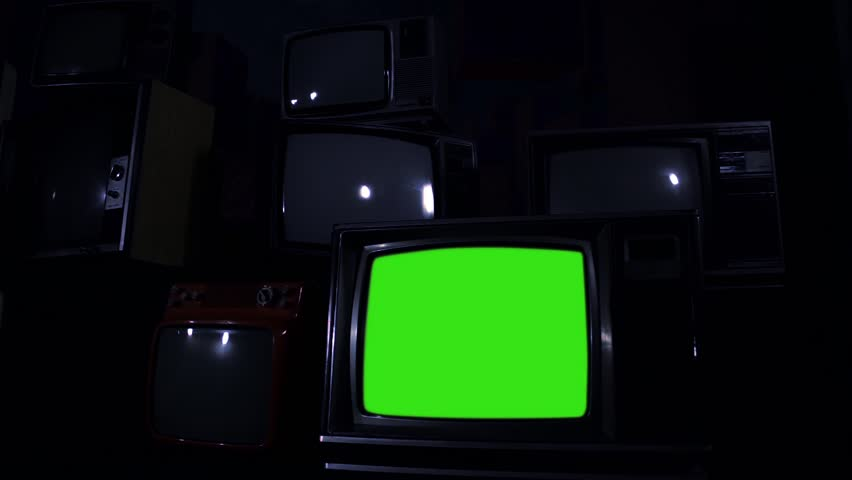 Old Tv Green Screen In The Middle Of Many Tvs. Night Tone. | Shutterstock HD Video #1024617743