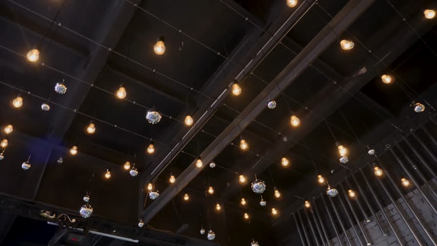 dark ceiling with hanging bright lights over the great hall #1024623746