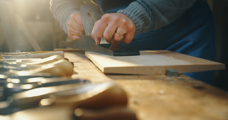 Slow motion close up of master artisan luthier working on creation of handmade violin  in a workshop. Shot in 8K. Concept of spiritual instrument, handmade, art, orchestra, artisan, passion for music | Shutterstock HD Video #1024625216