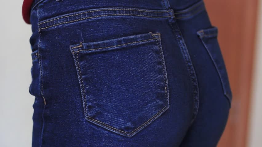 Female hand climbs into the pocket of jeans on the ass | Shutterstock HD Video #1024627310