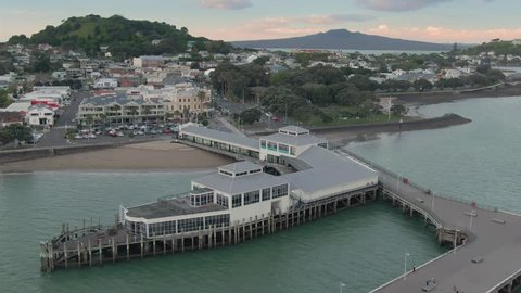 Aerial: Devonport Town Center & Ferry Terminal. In the background is Mt Victoria, North Head & Rangitoto Island. Auckland New Zealand