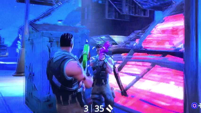 Video Game Playing Fortnite from epic games Closeup Footage. Playing popular game with big tv screen. 24th February 2019. Finland, Espoo.