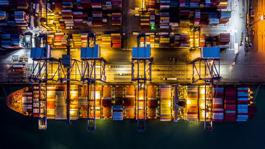 Time lapse 4K, Aerial top view Container cargo freight ship with working crane bridge discharge at container terminal, Business commercial container ship global at night, Freight shipment Singapore. | Shutterstock HD Video #1024664966
