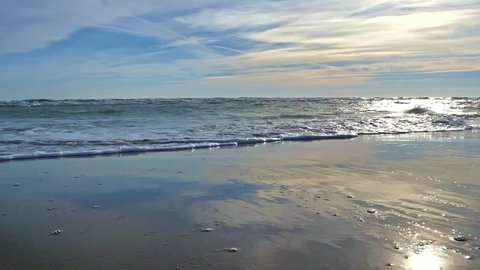 Sea Waves in the beach with clouds slow motion