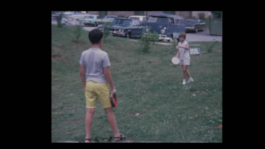 Young boy and girl play Tambourelli badminton