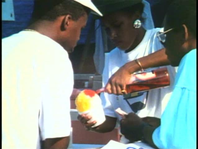 HAMILTON, BERMUDA, 1994, Snow cone stand, pour syrup at Labor Day picnic | Shutterstock HD Video #1024700981