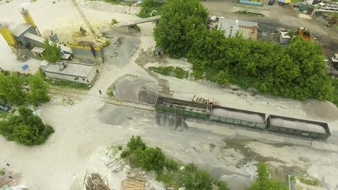 aerial shot of old concrete factory territory and nearby facilities