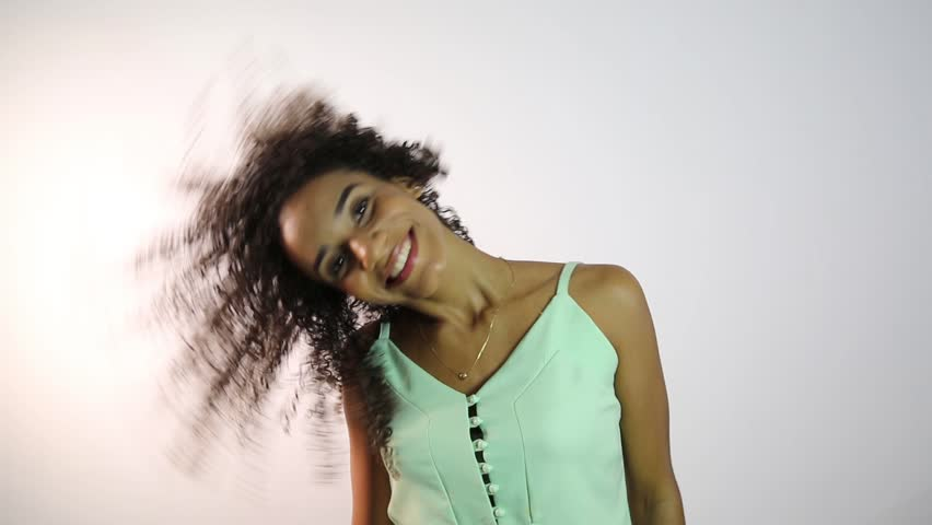 African American girl with afro hair on white background. Brazilian girl.   Shutterstock HD Video #1024714034