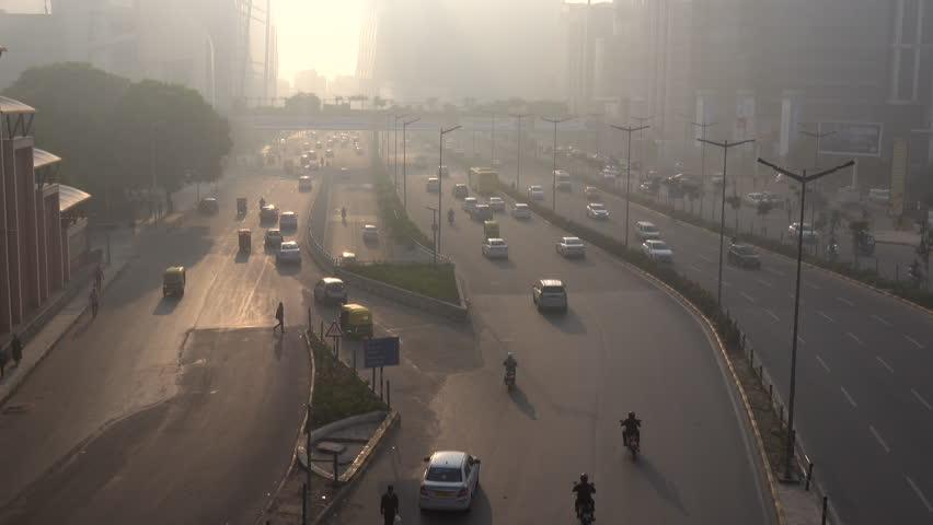 CYBER CITY, GURUGRAM, INDIA - NOV 24: Traffic and pedestrians in hazardous levels of air pollution on November 24, 2018 in Cyber City, Gurugram, India