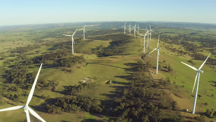 Aerial view of wind power turbines spinning. #1024743209