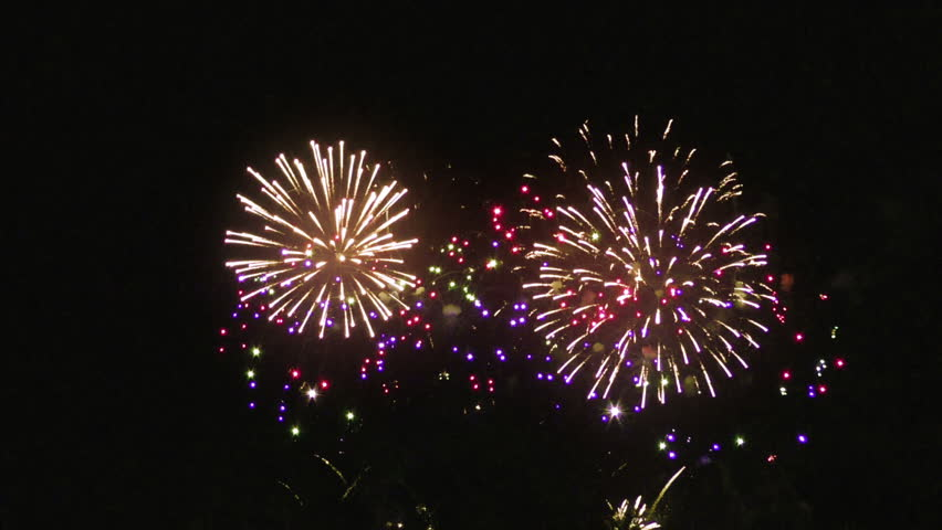 Colourful fireworks above night sky Royalty-Free Stock Footage #1024755338