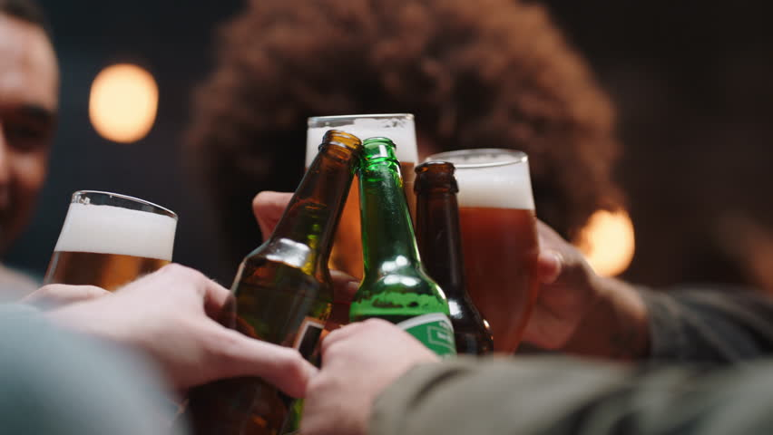 Happy group of friends making toast having fun drinking socializing hanging out at pub chatting sharing celebration enjoying evening reunion gathering | Shutterstock HD Video #1024763417