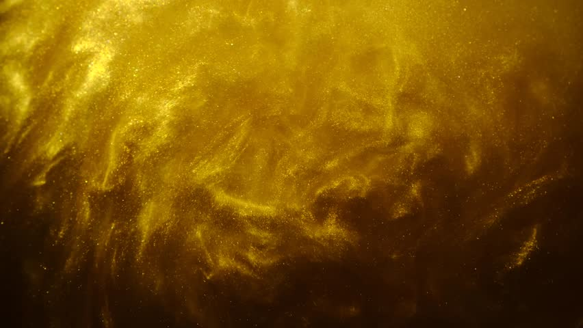 Golden sand or dust creating abstract cloud formations. Art backgrounds. #1024787123