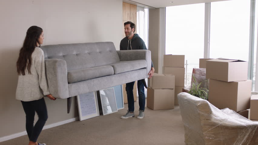 Young couple moving house new home owners smiling enjoying successful move hugging in apartment   Shutterstock HD Video #1024808072