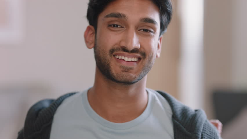 Portrait attractive young man smiling happy feeling confident enjoying successful lifestyle | Shutterstock HD Video #1024808075