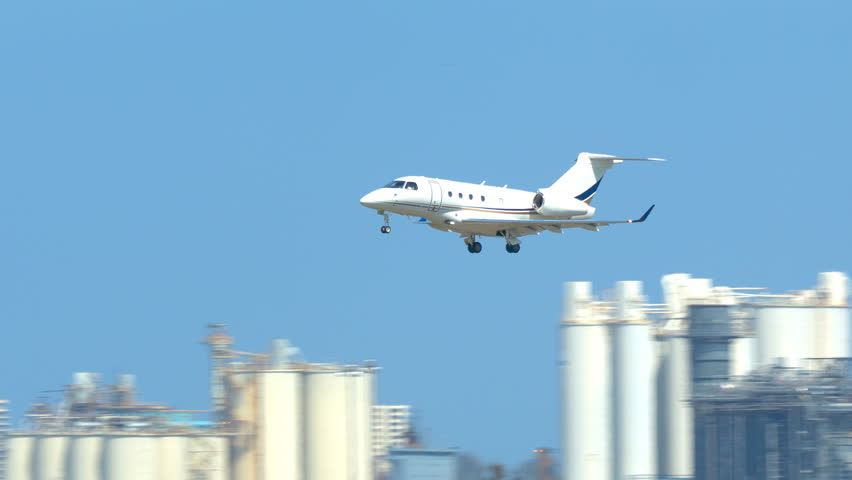 Generic Unmarked VIP Business Jet Private Airplane Landing at a South Florida Airport on a Sunny Day Royalty-Free Stock Footage #1024822784