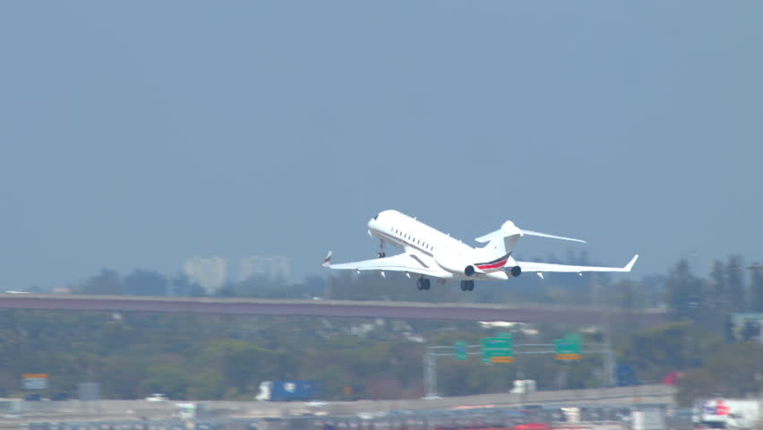 Generic Unmarked Executive VIP Business Jet Airplane Taking Off from a Commercial Airport Runway along other Aircraft on a Sunny Day Royalty-Free Stock Footage #1024822787