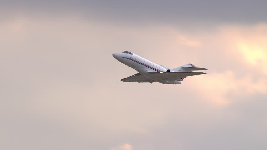 Generic Unmarked Executive VIP Celebrity Business Jet Taking off Into a South Florida Orange Sky