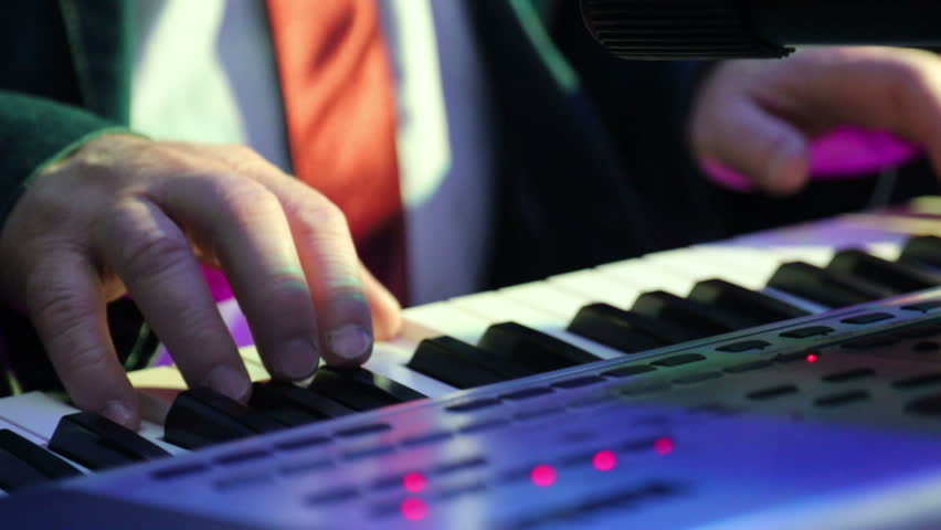 The fingers of an older man who plays an electronic synthesizer | Shutterstock HD Video #1024823870