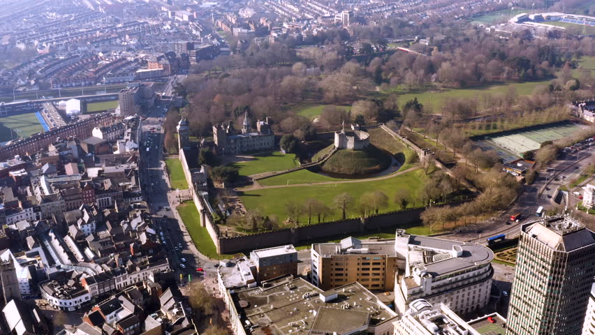 Cardiff Castle aerial view in Wales capital city feat. park and gardens skyline and cityscape on a sunny day in the UK   Shutterstock HD Video #1024837022