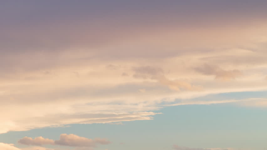 Russia, time lapse. Formation and rapid movement of white clouds of different shapes in the blue sky in late spring at sunset. #1024861460
