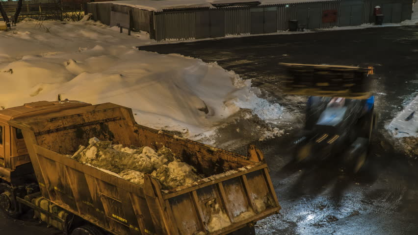 Night Snow loading by road machinery after heavy snowfall in residential block, time lapse | Shutterstock HD Video #1024865786