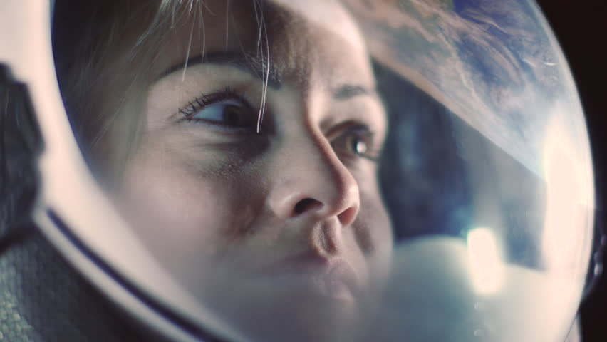 Portrait Shot of the Courageous Female Astronaut  Wearing Helmet in Space, Looking around in Wonder. Space Travel, Exploration and Solar System Colonization Concept. | Shutterstock HD Video #1024871762