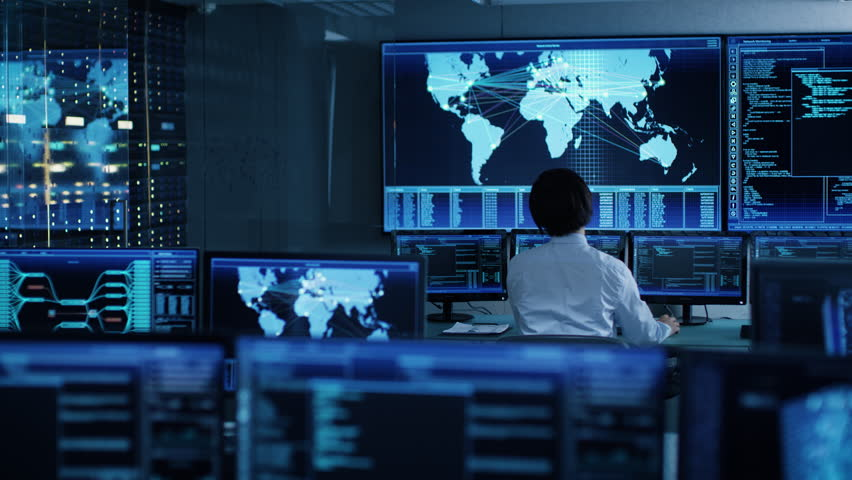 In the System Control Room Chief Operator Watches Screens With Satellite Data. Monitoring Station Has Capacity for Global Data and Monitoring, Every Interaction is Shown in Real Time on Displays Royalty-Free Stock Footage #1024872185