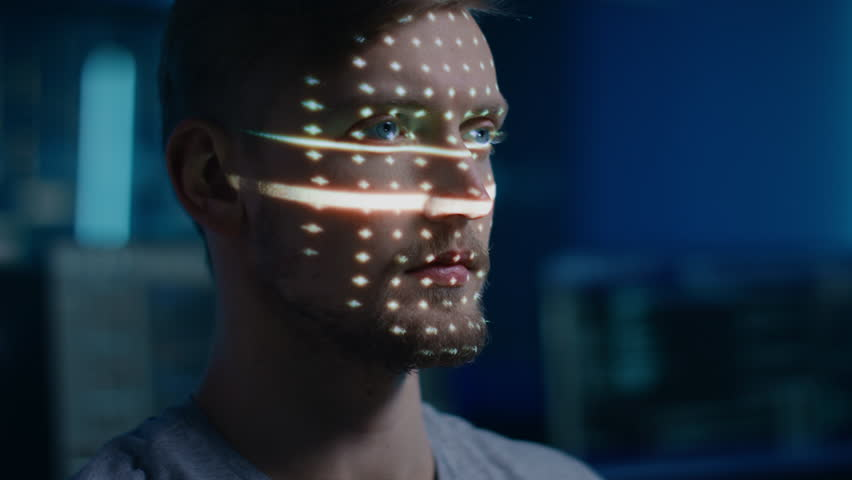 Handsome Young Caucasian Man is Identified by Biometric Facial Recognition Scanning Process. Futuristic Concept: Projector Identifies Individual by Illuminating Face by Dots and Scanning with Laser | Shutterstock HD Video #1024873967