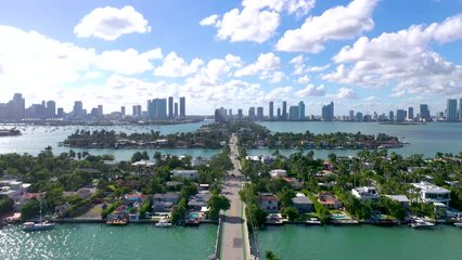 MIAMI, FLORIDA, USA - JANUARY 2019: Aerial drone panorama view flight over Miami. Venetian Islands and Biscayne Bay. Streets, hotels and residential buildings from above.