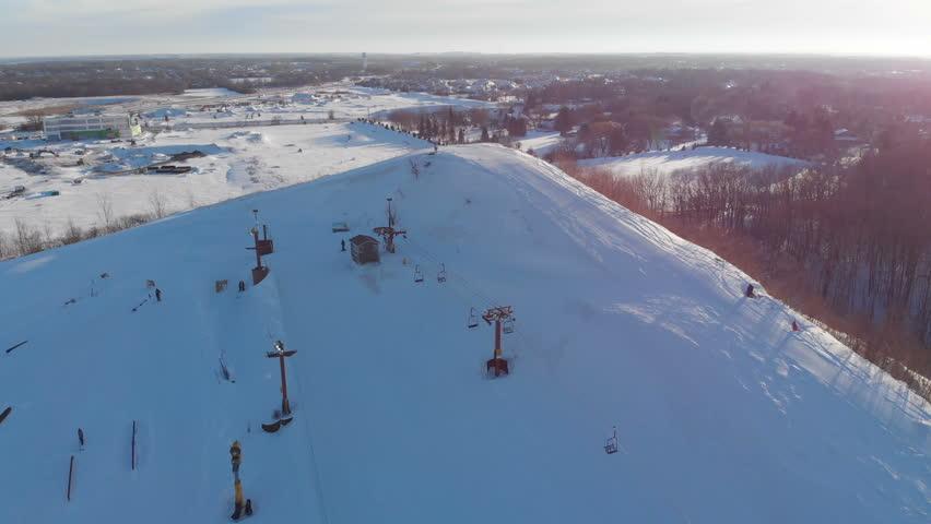 Snow park in Wisconsin, winter activities (tubing, skiing, snowboarding). Drone shots , bird's eyes view | Shutterstock HD Video #1024931417
