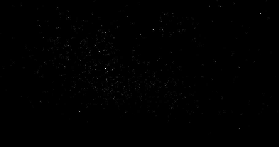 Flying dust particles on a black background #1024948598