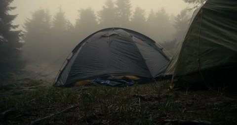 Spherical touristic tent is under heavy rain droplets in Carpathians in slo-mo