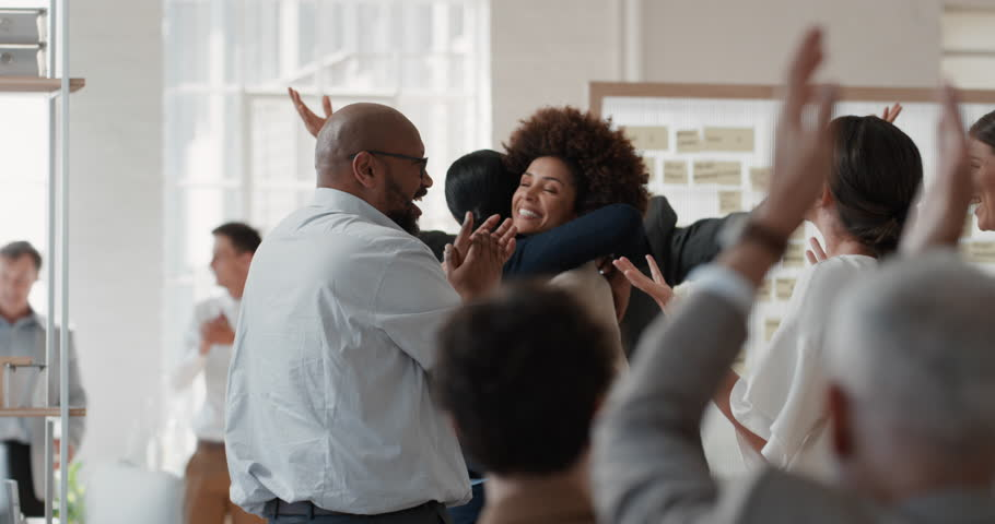 Happy business people celebrating successful corporate victory colleagues high five in office meeting enjoying winning success | Shutterstock HD Video #1025001005